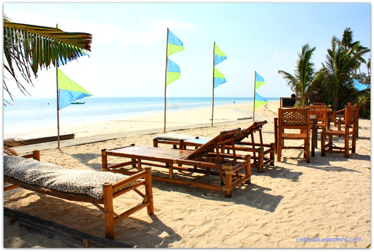 Beach loungers and view at Coral Blue Oriental Beach Villas & Suites on Bantayan Island, Cebu, the Philippines