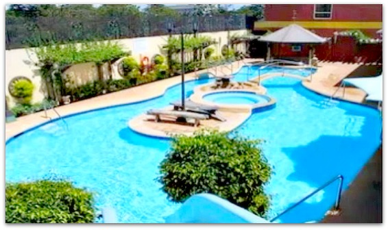 The swimming pool of Crown Regency Suites & Residences that is located in Mactan Island, Cebu, Philippines.