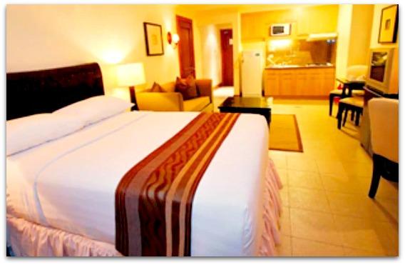 A Crown Regency Suites & Residences luxurious bedroom, Mactan Island, Cebu Province, Philippines