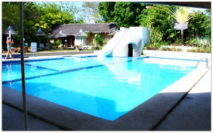 Marcosas Cottages Resort. Swimming pool view and cottages at the background, Panagsama, Basdiot, Moalboal, Cebu
