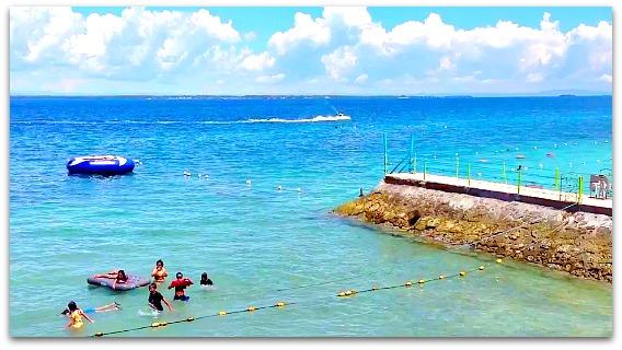 Visitors enjoying the nice beach of Portofino Beach Resort on Mactan Island, Cebu, Philippines.