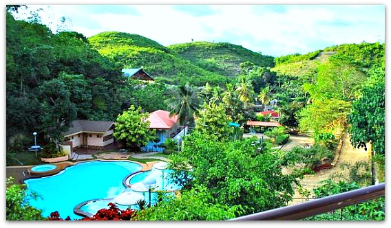 View of the pool of Genesis Mountain Valley Resort from a window